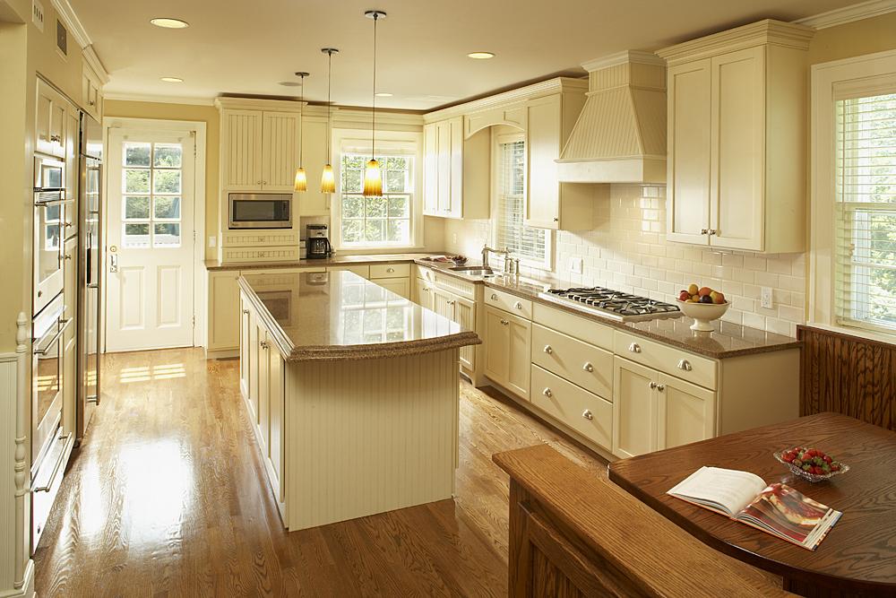 https://www.sattlerhomes.com/wp-content/uploads/2017/11/brown-counter-top-kitchen-w-white-cabinets.jpg